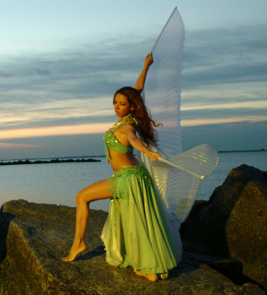 Sira gazes into the distance, while her gossamer bellydance wings fluitter in the breeze.