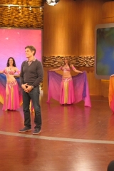 Sira performs with a troupe of backup dancers on the Dr Oz television show