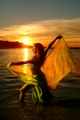 Belly dancer NY, Sira, wafts a veil in a fleeting moment during golden hour at the seaside