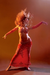 Belly dancer Sira dances wildly, with her long hair swinging