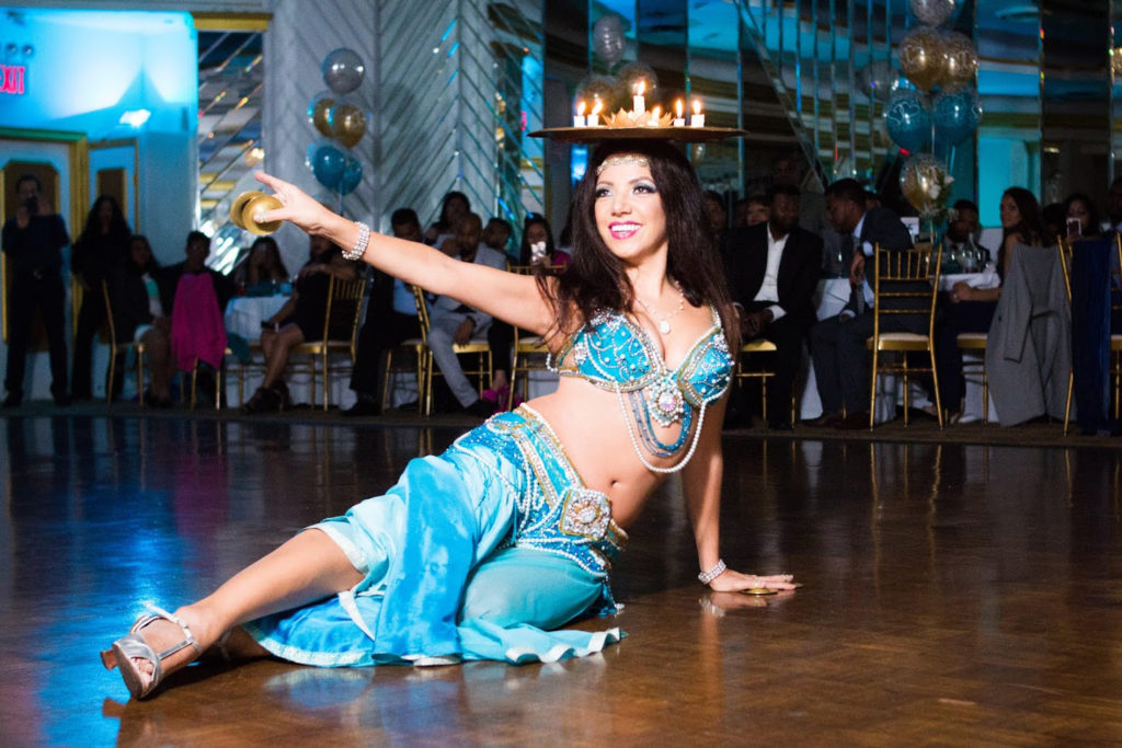 Sira, a professional NYC belly dancer performs with candle tray for a wedding engagement party